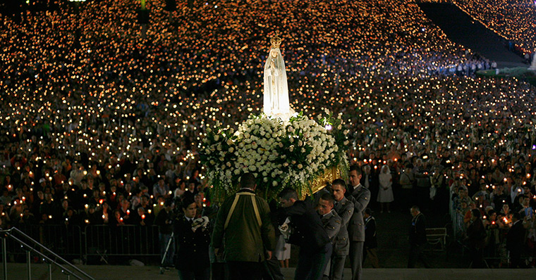 Portugal: A statue of the Holy Virgin Mary of Fatima is carried