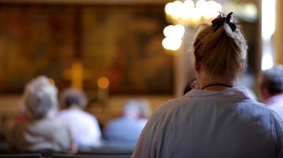 stock-footage-view-from-behind-of-people-sitting-in-church-in-copenhagen-denmark